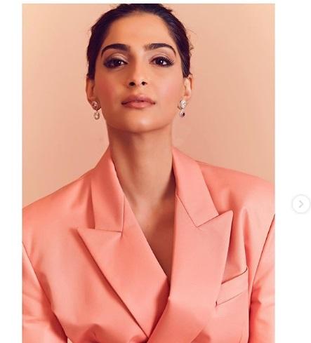 Sonam Kapoor Ahuja looks glamorous in this Fenty coral pantsuit