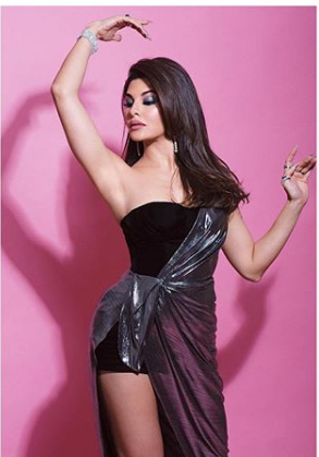 Jacqueline Fernandez looks stylish and chic in metallic one-shoulder dress