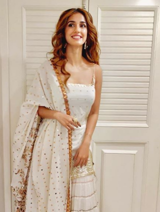 Disha Patani looks elegant in white and golden sharara