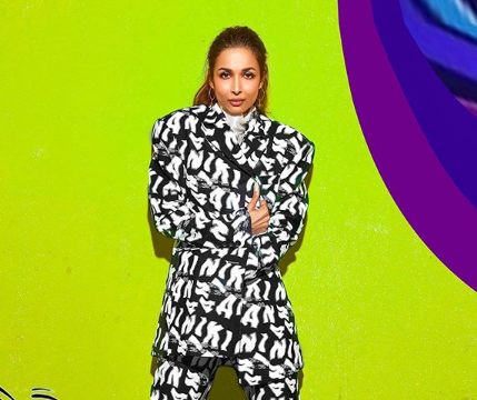 Malaika Arora stuns in sheer top and monochrome suit