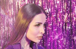 Malaika Arora looks hot in a purple powersuit