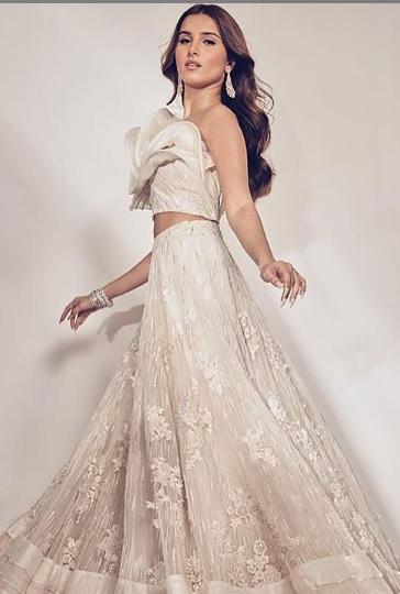 Tara Sutaria stunning in white lehenga